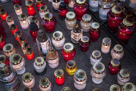 all saints day: A lot of lighted candles on All Saints Day