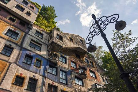 VIENNA, AUSTRIA - JULY 18, 2013: Bottom view on exterior of famous colorful Hundertwasser house in Vienna, Austria.