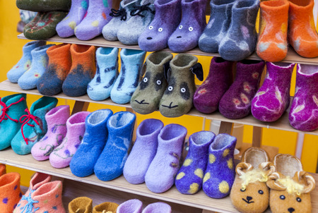 valenki: Colorful child felt boots displayed in marketplace