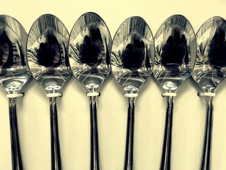 silver: Row of shining spoons at shop display Stock Photo