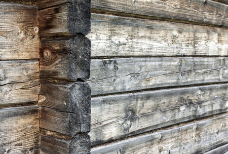 log wall: Horizontal picture of natural weathered wooden log wall background
