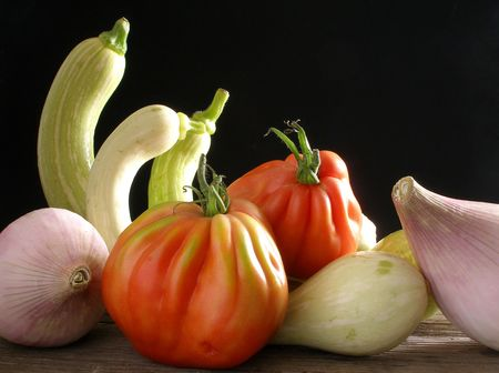 unusual vegetables: A selection of trumpet zucchini,beef tomato and sweet onion; 3 of them unusual vegetables but very tasty