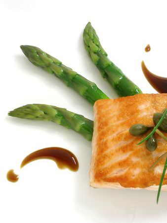 capers: Panfried salmon with asparagus and capers Stock Photo