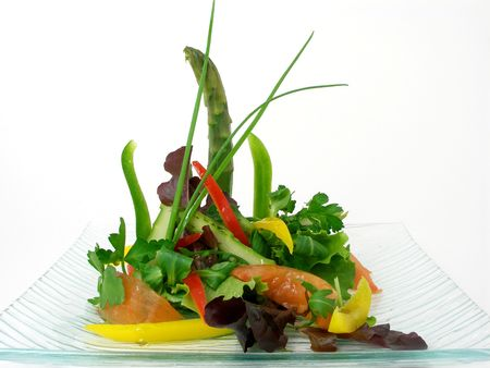 entrees: Salad of vegetables and asparagus in a glass plate Stock Photo