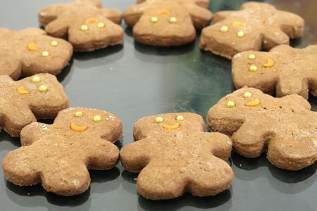 rhyme: Ginger bear cookies with golden ball eyes and orange sickle smile Stock Photo