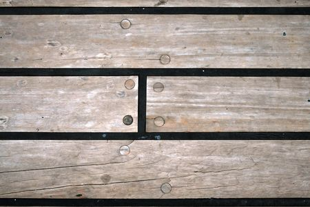 rubber sealant: A wooden floor with screws and rubber sealing on the deck of a ship