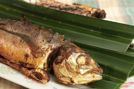 stuffed fish: Malaysian pan fried whole mackerel with chili stuffing Stock Photo