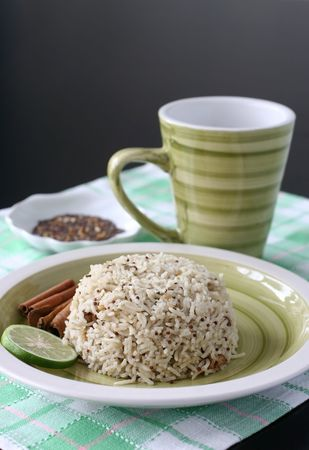 indian cookery: Asian exotic spiced rice served in a green earthenware plate set