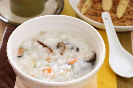 medium body: Chinese white dimsum porridge with sliced mushrooms and vegetables