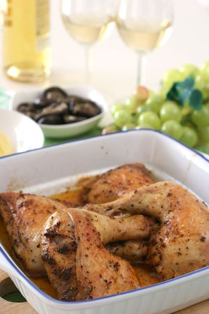 Chicken thigh and leg pieces baked with light Cajun spices and olive oil photo