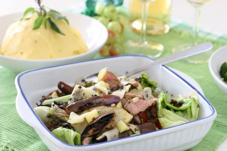 Healthy and light mushroom, fresh lettuce, brinjal and sliced grilled beef salad photo