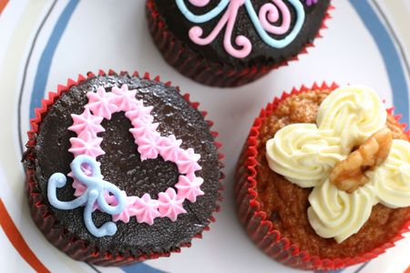 indulgent: Fancy carrot and chocolate cupcakes with icing design on top