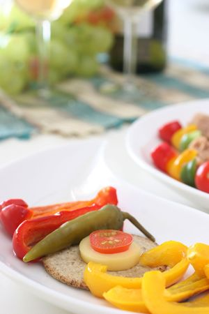 Healthy colorful vegetable platter with assorted vegetables, fish and biscuits photo