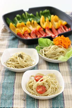 olio: Assorted dishes of Pasta olio with multi colored rows of capsicums Stock Photo