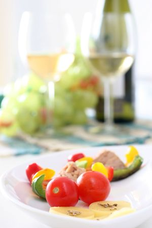 Healthy colorful vegetable platter with assorted vegetables, cheeses and wine photo