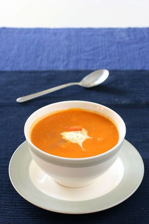 dollop: Carrot  and orange soup with a dollop of creamy yogurt and sprinkle of thyme