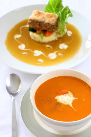 Carrot  and orange soup with a dollop of creamy yogurt and sprinkle of thyme photo