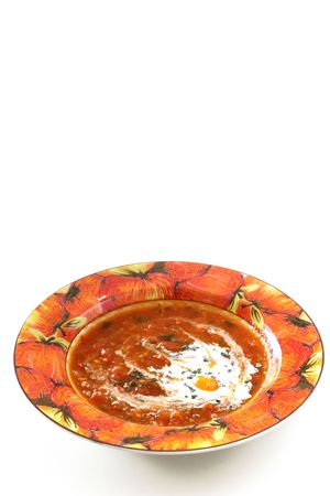 Chunky homemade tomato soup with chopped basil and garlic and a dash of olive oil photo