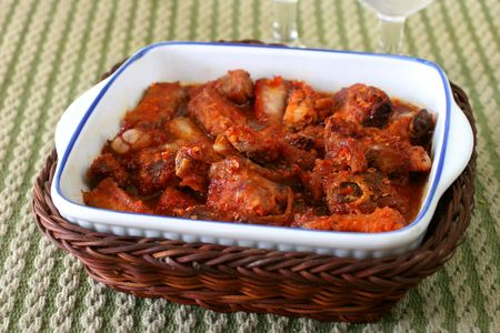 Barbequed oriental spicy pork ribs in white casserole dish photo