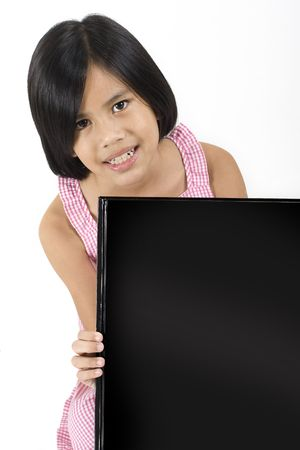 Young pretty Eurasian Chinese girl in pink dress  holding up large black rectangle photo