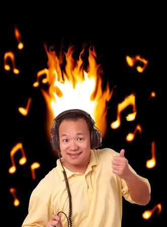 electrifying: Oriental Chinese man with headphones dancing to fiery music notes Stock Photo