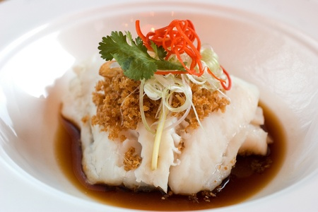 simple fish: Imperial fillet of cod garnished with garlic floss, scallion, cilantro and chilli
