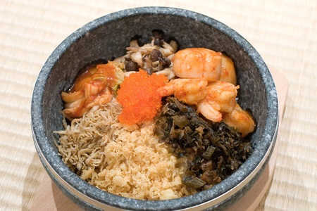 shiitake: Japanese stone bowl mixed rice with scallop, caviar, mini anchovies and mushrooms Stock Photo