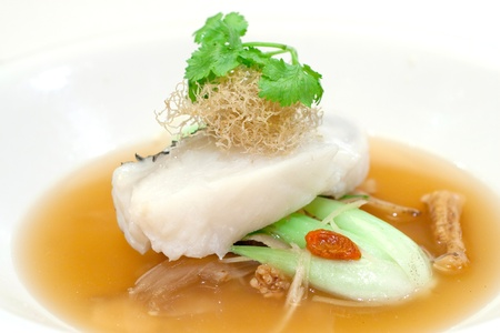 fine fish: Steamed fillet of cod on a bed of vegetables in wolf berry sauce, topped with shredded fried ginger and  Chinese parsley