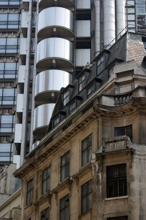 lloyds: Contrast of modern (the Lloyds Building) and traditional commercial architecture on Cornhill in Londons financial district. Stock Photo