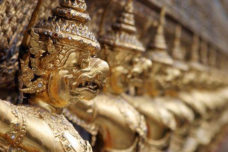 gargoyles: A row of gargoyles outside the shrine of the Emerald Buddha in Wat Po, Bangkok, Thailand. Stock Photo