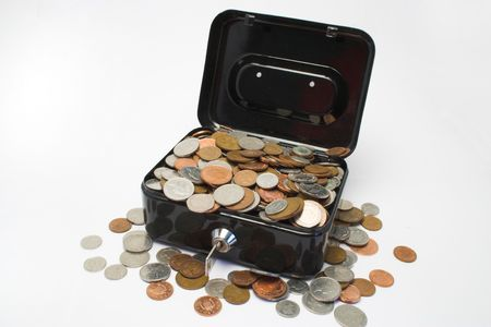 A metal box with a key,full of coins Stock Photo