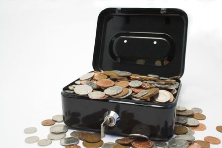 strongbox: A metal strongbox full of coins Stock Photo