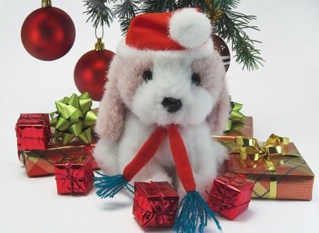 Christmas presents under the tree with a toy dog