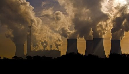 A factory and power station belching pollution Stock Photo