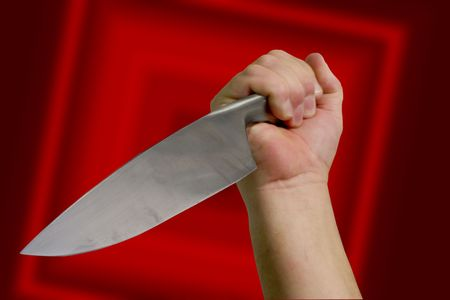 A knife wielding attacker. With clipping path.