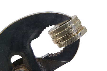 vice: Coins held in a vice