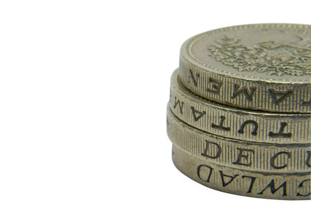 A pile of pound coins with copy space photo