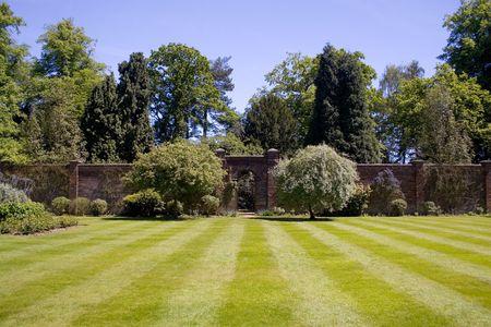 A walled garden with a beautiful lawn. With room for copyspace Stock Photo