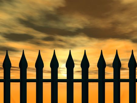 A  fence against a golden sunset photo