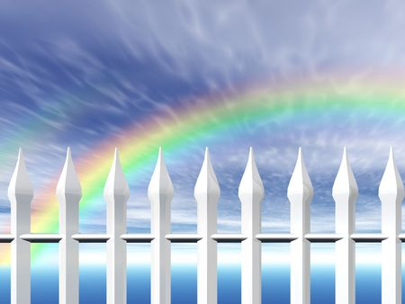 A white fence with a rainbow in the background photo