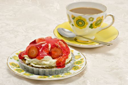 gateau: A delicious strawberry gateau and a cup of coffee on a damask cloth