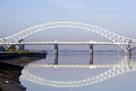 Two bridges span the River Mersey side by side.