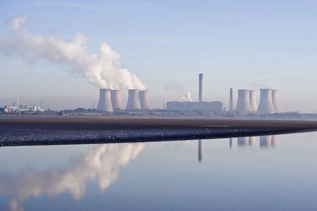 A power station reflected in the river  Stock Photo