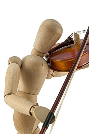 wooden figure: A wooden mannequin playing the violin. Stock Photo