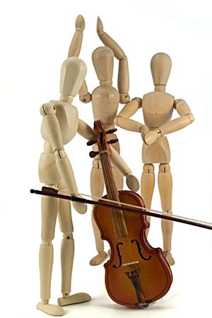 A wooden mannequin playing the violin. Stock Photo