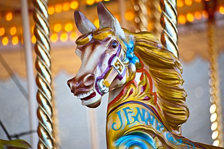 fairs: A colorful wooden horse on a carousel ride