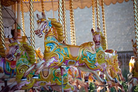 Colorful wooden horses on a carousel ride