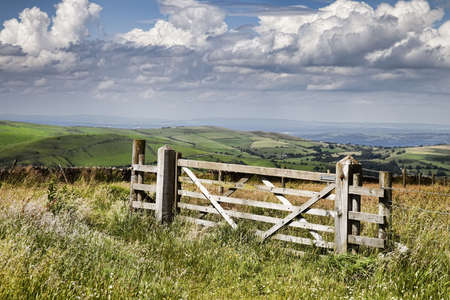 pasture fence: Countryside gate with a wonderful sky Stock Photo