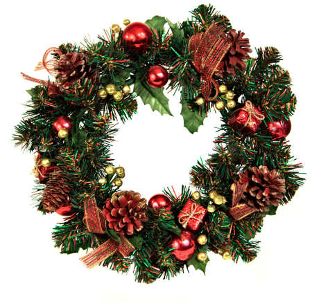 A decorated Christmas wreath with pinecones and ornaments Stock Photo