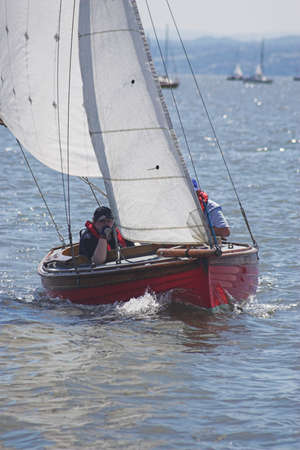 propel: A man and woman racing in their yacht
